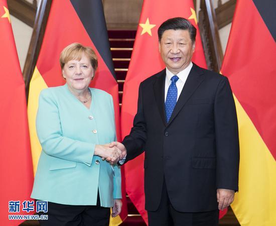 """海外网评:默克尔""""深度中国行""""背后大有深意"""